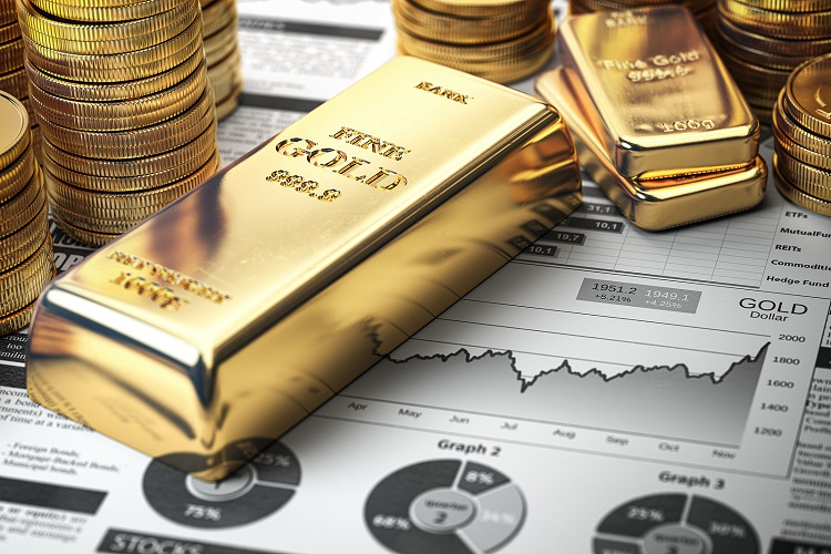 Gold bar, ingots and coins on financial report. Growth of gold